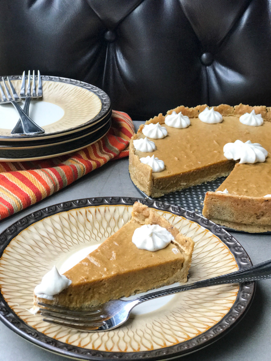Perfectly creamy, pumpkin filling that's light as air and snuggled in a paleo-friendly hazelnut crust, topped with maple cinnamon whipped coconut cream. Here's to a happy, healthy Thanksgiving! | lifepurposefull.com/food